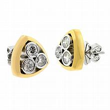A PAIR OF DIAMOND STUD EARRINGS; each an 18ct gold triangular frame rub set in white gold with 3 round brilliant cut diamonds to pos...