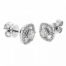 A PAIR OF 18CT WHITE GOLD DIAMOND STUD EARRINGS; each a princess cut diamond of approx 0.22ct VS/I-J surrounded by 20 round brilliant..