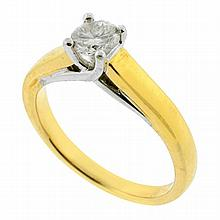 A SOLITAIRE DIAMOND RING; four claw set in 18ct two tone gold with a round brilliant cut diamond of approx 0.50ct SI1/M. Size O 1/2