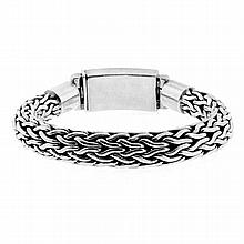 A STERLING SILVER BRACELET; 10.55mm wide fancy plaited foxtail chain to box clasp internal circumference 154mm, wt