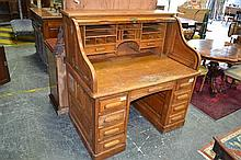An Unusual American Oak Roll Top Desk by Thomas Turner with hinged flaps & 9 drawers (key in office)