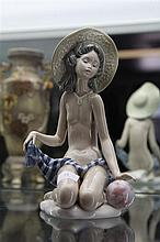 Lladro 'On The Beach' Figure of Girl in Sun Hat, finger chipped by Salvador Dobon