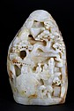 A Finely Carved White Jade Boulder