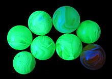 8 Peltier Glass Company Slag Marbles. Previously in the collection of George Jinkerson.