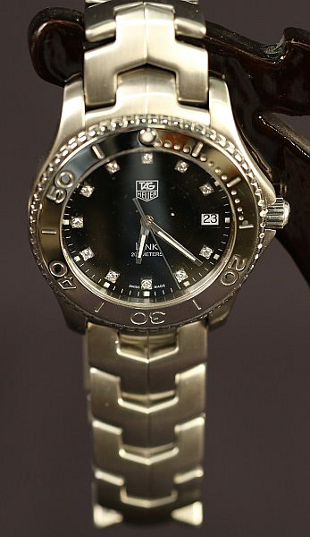 STAINLESS STEEL TAG HEUER BLACK DIAL WATCH.