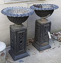 Pair of Black Urn Form Jardinieres on Reticulated Stands
