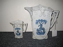 Two German porcelain jugs with blue windmill decoration