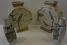 Pair of glazed earhenware disc-form vases with painted parrot decoration,  9 3/4 in