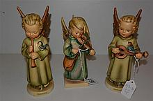 Three Hummel figurines, 'three-line' marks