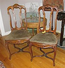 Pair of antique Continental Baroque style side chairs, with scrolling acanthus carved crests, wicker inset seats and cabriole legs c...
