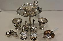 Collection of sterling and plated silver small table articles: condiment pots with spoons, footed creamer, shakers, compote and matc...