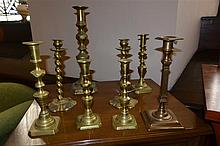 Eight assorted antique brass candlesticks