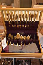 59-piece Dirilyte golden-hued flatware service