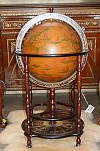 Globe on wooden stand as a bar