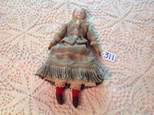 Antique Doll with porcelain head, leather arms.