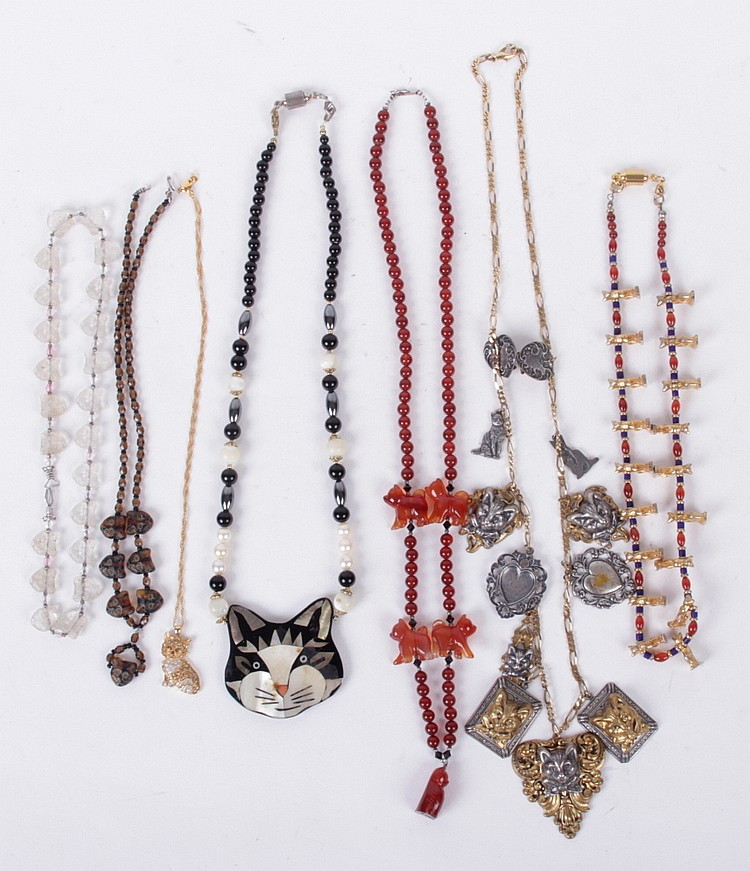 A Group of Cat Decorated Necklaces