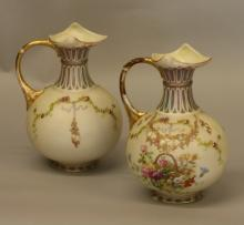 A Pair of Jugs. Probably Continental, circa 1900. In the Royal Worcester style