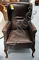 WINGBACK ARMCHAIR, brown leather, on cabriole
