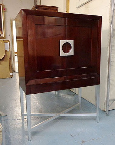 CABINET, designed by Johnson Stewart, having three