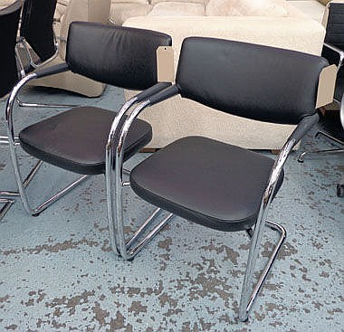 EASY CHAIRS, a pair, in black leather, on chrome