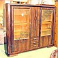 BOOKCASE, Art Deco Macassar ebony, of two glazed doors, flanking a panel door and three drawers, 196cm W x 166cm h x 41cm D.