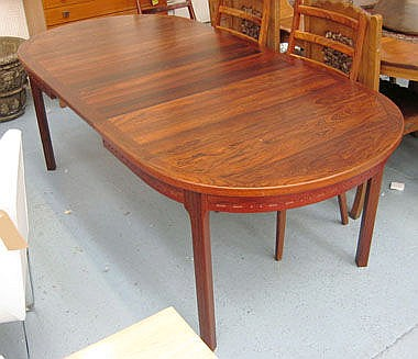 DINING TABLE, Danish rosewood on rounded supports,