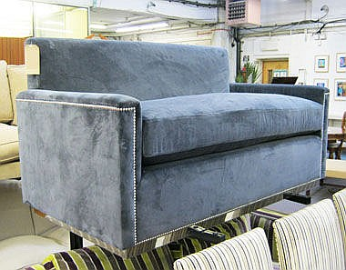 SOFA, in midnight blue velvet with chrome studs,