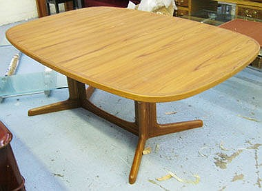 DINING TABLE, in Danish teak, extending with two