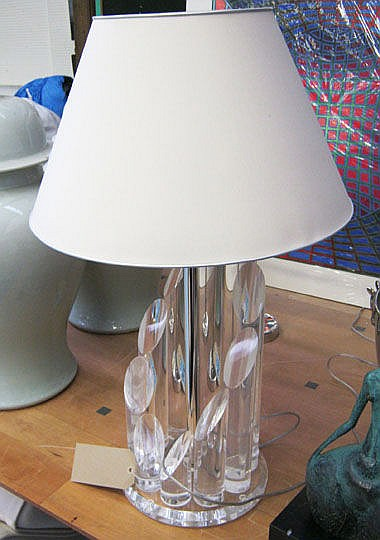 LUCITE LAMP, of circular form on chrome support