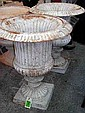 GARDEN URNS, a pair, cream painted/rust reeded cast iron. (2)