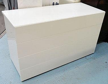 CHEST, in white finish with four drawers below,