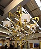 CHANDELIER, four branch in gilt metal frame with