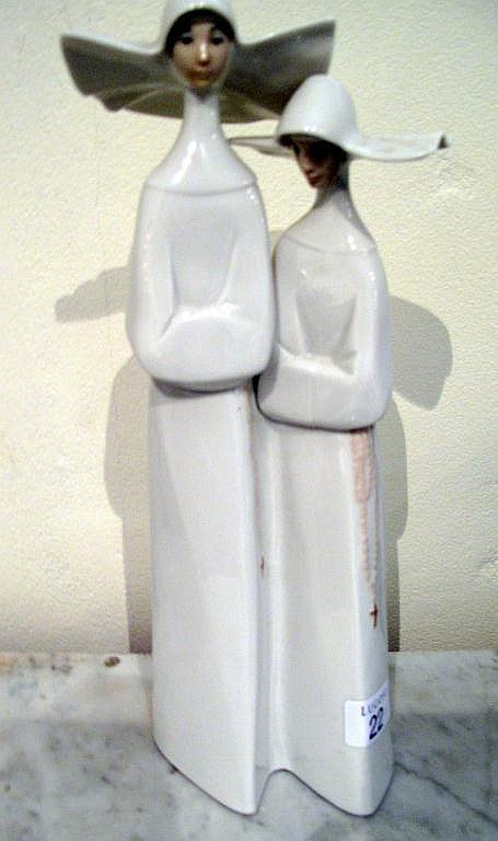 Lladro figure of two nuns measures 34cms ht