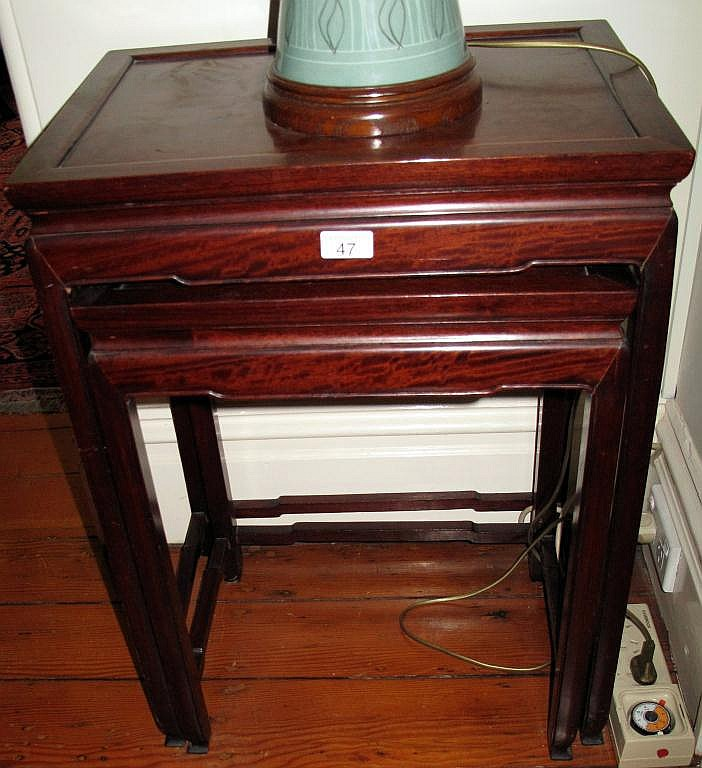 Chinese hardwood nest of four tables
