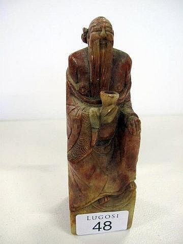 Chinese carved russet soapstone seated figure