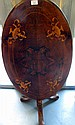 Antique inlaid walnut oval tilt top table on