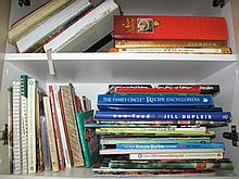 Two shelves of various cook books