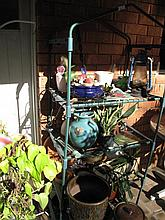 Green pot stand with various pots and bric a brac