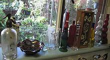 Shelf various glass bottles bowls etc