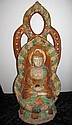 Unusual Chinese Sancai Glazed Buddha holding an