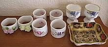 Royal Crown Derby pin dish & pair Royal Albert egg cups with six various serviette rings, Wedgwood vase with Royal Doulton Norfolk plate, Widdecombe Fair jug measures 14.7cm tallest