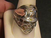 Biker's Skeleton Helmet Yellow & Green Sapphire Ring.