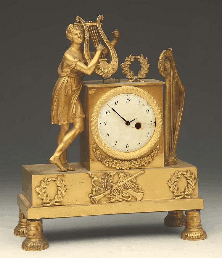 A 19TH CENTURY FRENCH GILT METAL TIMEPIECE with