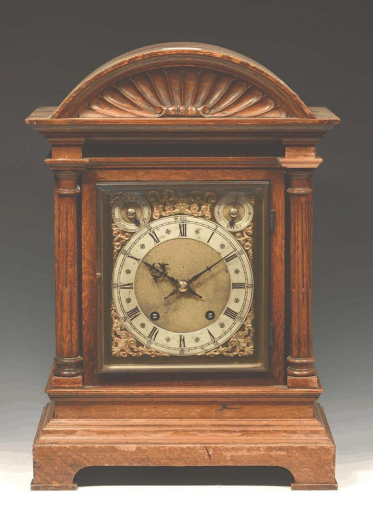 A GERMAN OAK BRACKET/TABLE CLOCK, the rectangular