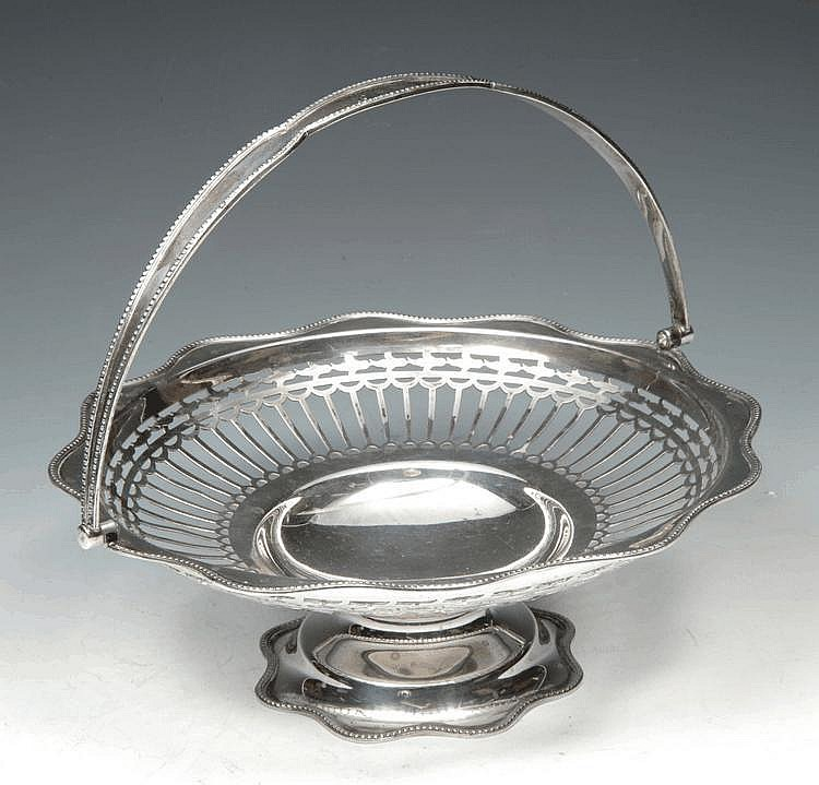 A GEORGE V CIRCULAR PIERCED SILVER BASKET with