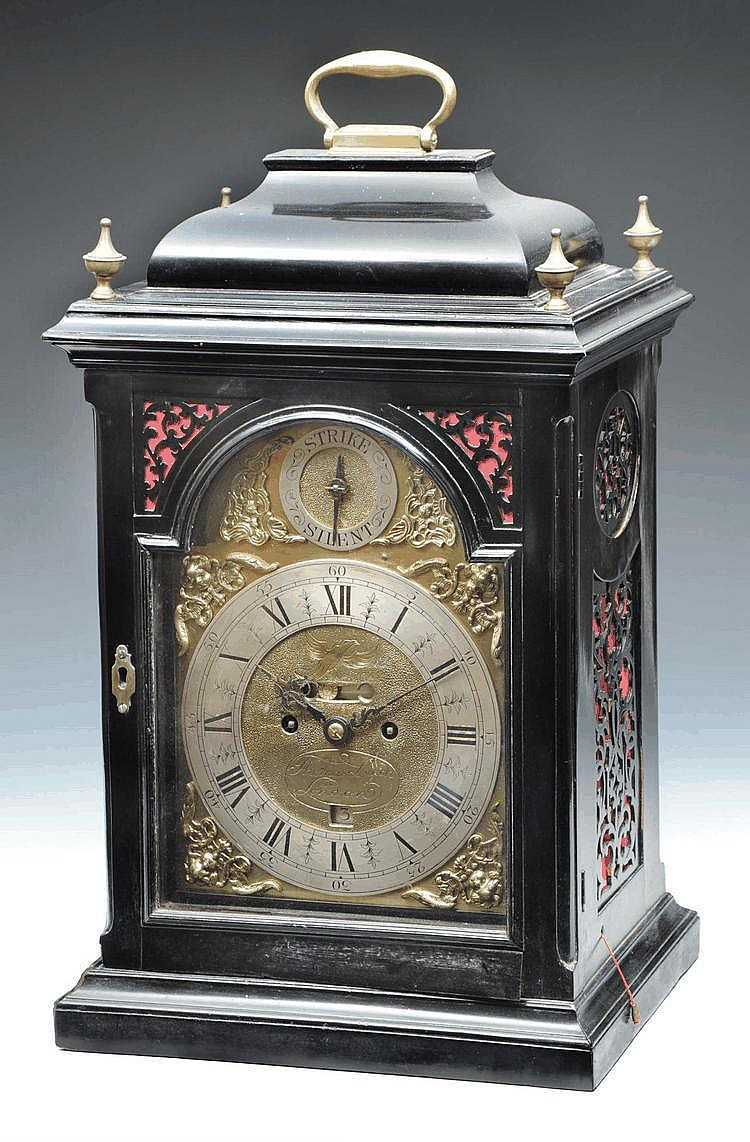 AN EBONISED BRACKET CLOCK The break arch brass