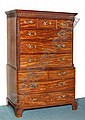 A GEORGE III MAHOGANY TALLBOY with carved blind