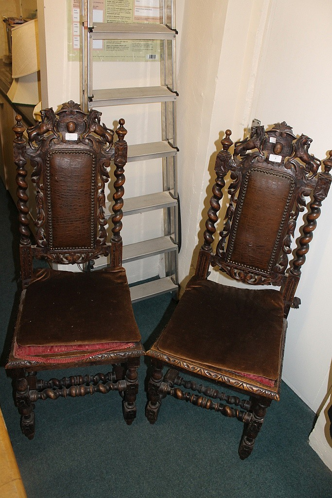 A PAIR OF VICTORIAN CARVED OAK HALL CHAIRS with