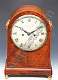 A GEORGE III MAHOGANY BRACKET CLOCK with circular white enamel dial and Roman numerals, signed Yonge and Son, Strand, London, with engraved back plate and striking on a single bell, the case with brass ring handles, grill sides and boxwood line inlay