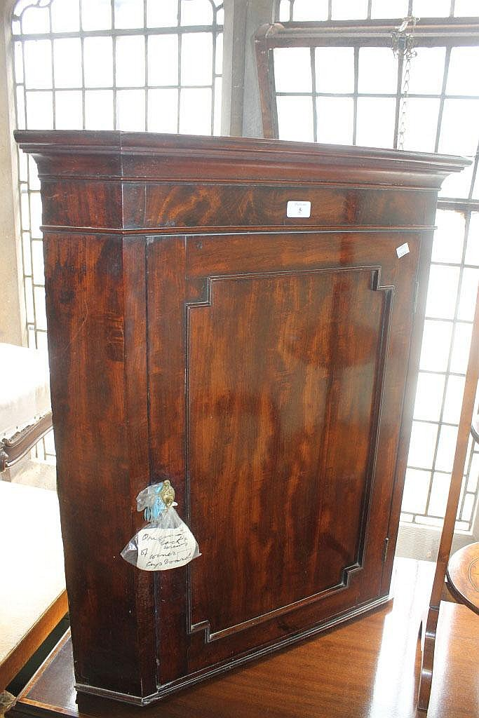 A GEORGE III MAHOGANY SMALL CORNER CUPBOARD with